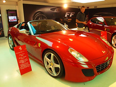 model car(0.0), automobile(1.0), automotive exterior(1.0), ferrari 599 gtb fiorano(1.0), vehicle(1.0), automotive design(1.0), auto show(1.0), ferrari s.p.a.(1.0), land vehicle(1.0), supercar(1.0), sports car(1.0),