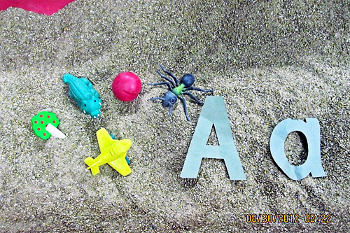 A-items-in-sand
