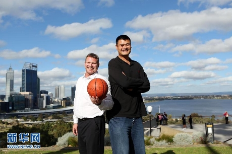 September 24th, 2012 - Yao Ming poses with Perth Wildcats owner Andrew Vlahov with the Perth skyline behind them