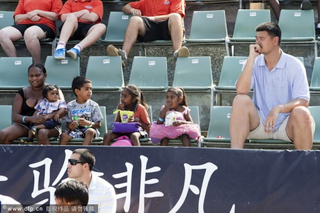 September 27th, 2012 - Yao Ming sits in the stands next to small children as he watches is Shanghai Sharks beat Singapore