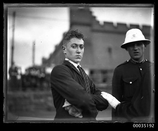 Injured man with a policeman at Fort Macquarie after GREYCLIFFE disaster, 3 November 1927