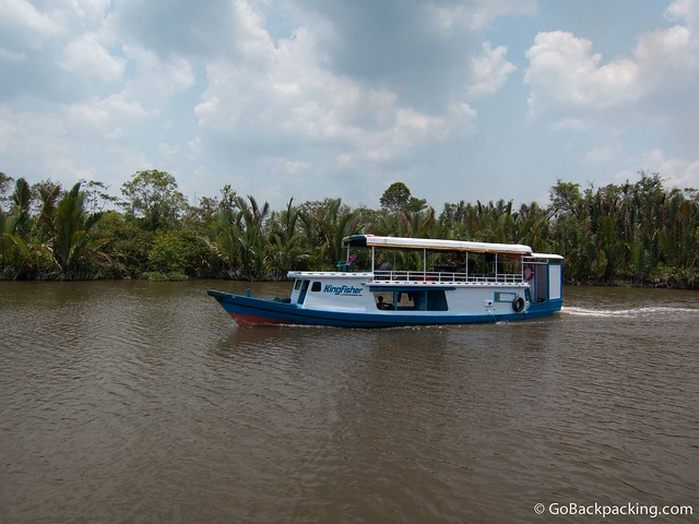 A klotok travels upriver in Indonesian Borneo