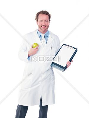 portrait view of a doctor with apple and clipboard