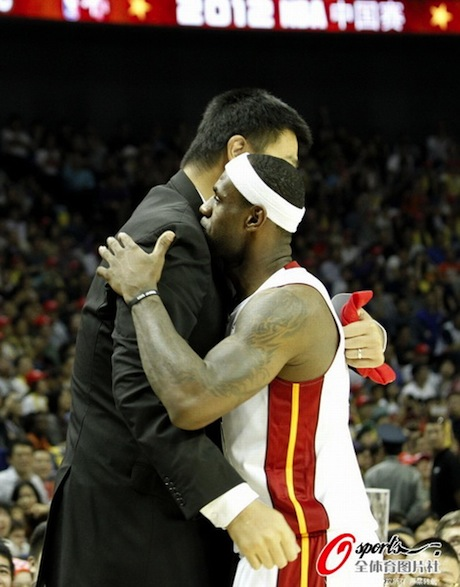 October 14th, 2012 - Yao Ming and LeBron James hug in Shanghai before the Clippers-Heat exhibition game