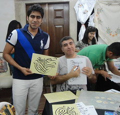 Image of a student with a calligrapher from a WFC trip