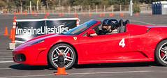 race car(1.0), automobile(1.0), wheel(1.0), vehicle(1.0), automotive design(1.0), ferrari f430(1.0), ferrari 360(1.0), land vehicle(1.0), luxury vehicle(1.0), supercar(1.0), sports car(1.0),