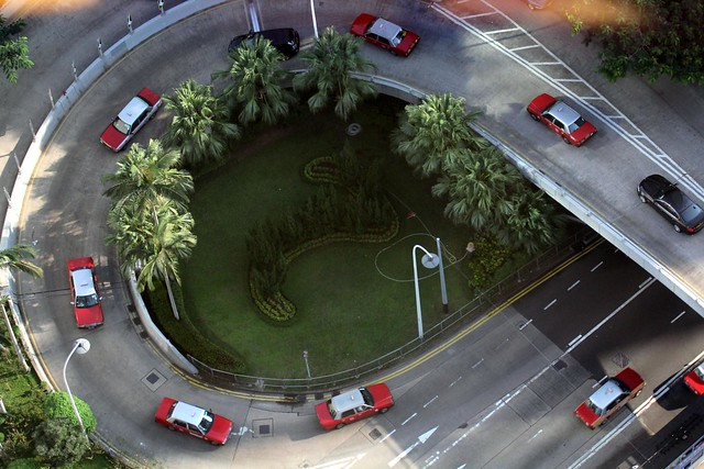 Red Toyota Crown Taxis Dominate Hong Kong Roads - Aerial view