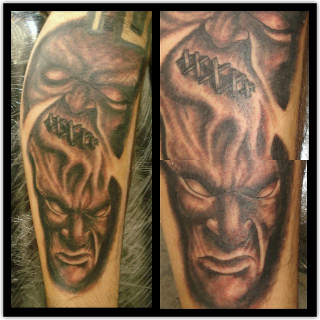 Evil demon face with face with stitches on top tattoo for Evil faces tattoos