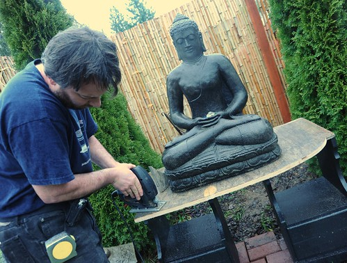 Stephen Klineburger sawing, tape measure, altar for Buddha statue, religious carpendry, bamboo, trees, A Garden for the Buddha, Seattle, Washington, USA by Wonderlane