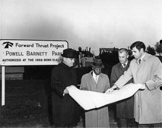 Powell Barnett looking at park plans, 1970