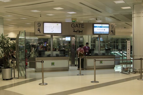 Gate 9 at Doha International Airport - the escalator to the downstairs bus bay is behind