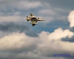 TA-4J AGAINST PUFFY CLOUDS
