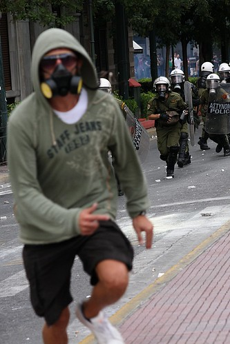 Greek protester running away from riot police units by Teacher Dude's BBQ