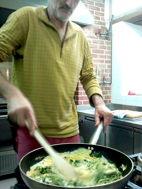 Dario prepares nettle and hop Scrambled eggs