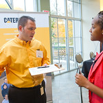 IF5 -- Internship Fair. Caterpillar rep Michael Jackson '99 with Beatrice Koka '16.
