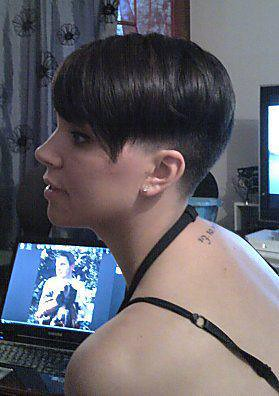 Buzzed nape and side very short girl haircut