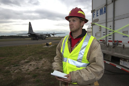 U.S. Forest Service employee Jordon Sanders from Harlan, IA., waits for military aircraft to drop off more supplies in response to Hurricane Sandy at the Republic Airport in Farmingdale, NY, on Thursday, Nov 1, 2012. USDA photo by Dave Kosling.