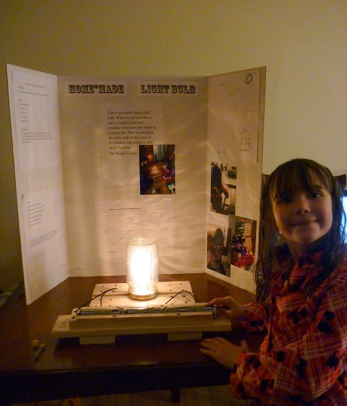 Ayla with her Finished Science Fair Project: A Homemade Lightbulb!