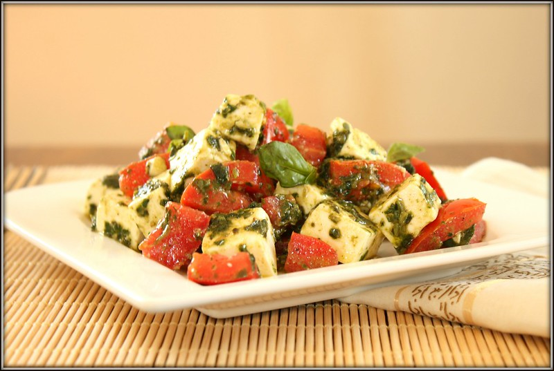 feta and tomato salad in a basil vinaigrette