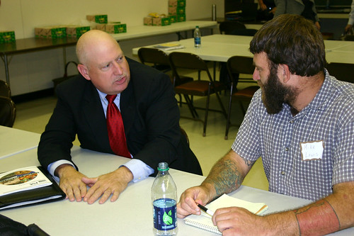Jim Radintz (left) from the FSA Farm Loans Programs met one-on-one with producers to educate them about microloans and other FSA loan opportunities.