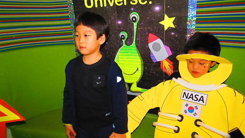 1st graders explore space cut outs