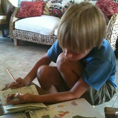 Labeling his Passport from @MasterBooks4u Passport 2 the World -Geography studies #homeschool #hsmommas