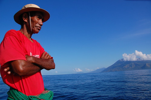 Indonesian Bapak stares at sea