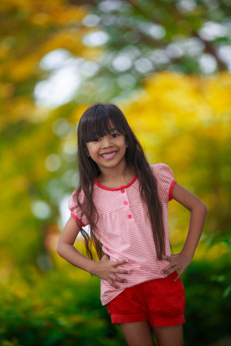 life park flowers tree cute green colors girl face childhood smiling horizontal closeup asian fun thailand outdoors happy eyes asia child cheek little bokeh expression lifestyle happiness lips health thai attractive attract express lovely activity facial feelings active frontview yearsold 57yearsold