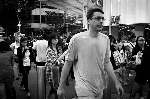 Man crossing over to Cineleisure, Singapore.