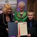 Receiving certificate from Mayor and Mayoress