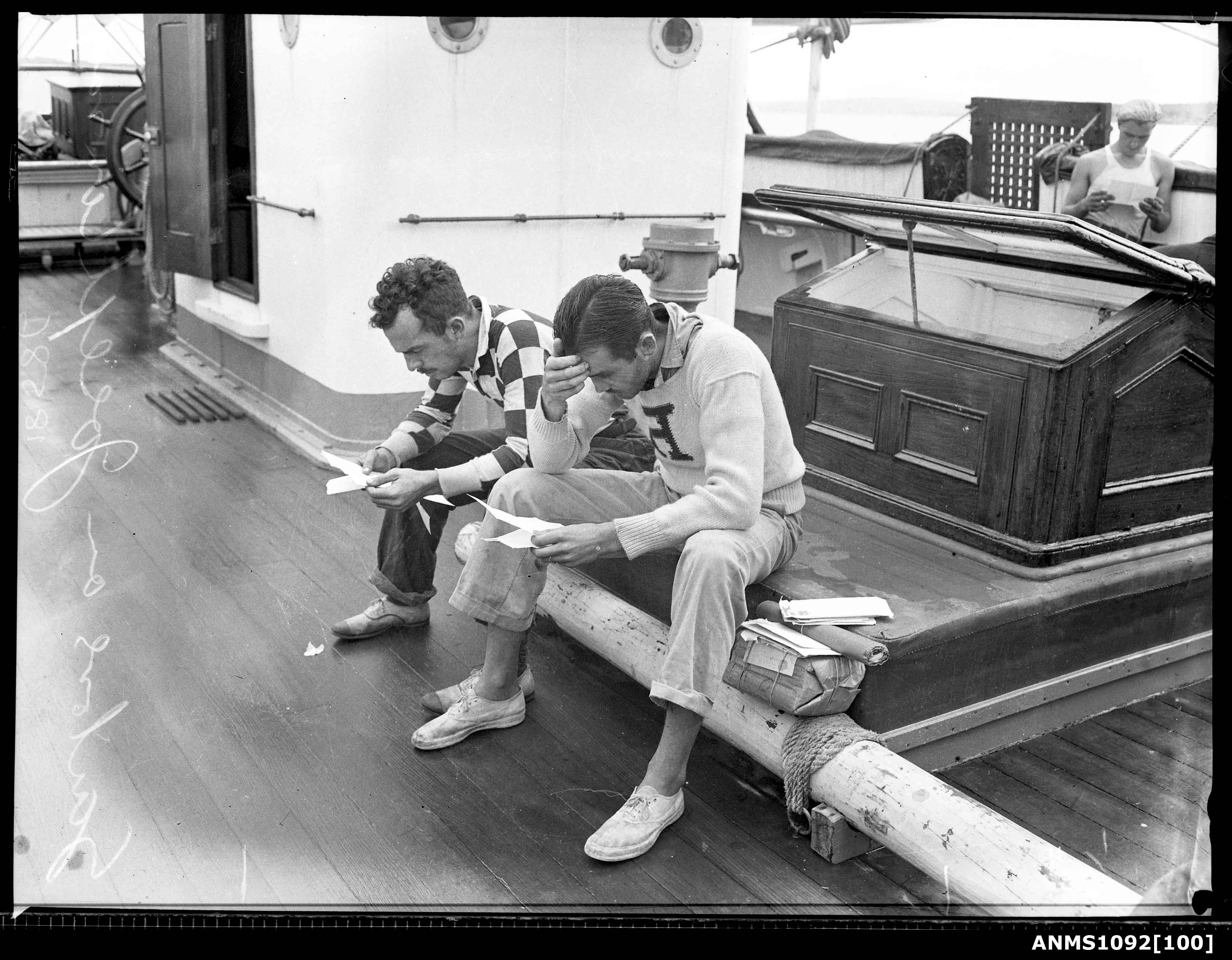Sailors reading mail onboard JOSEPH CONRAD