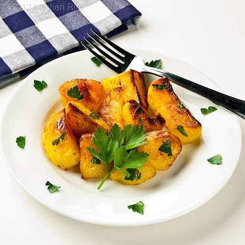 Roast Potatoes on Plate with Parsley Garnish