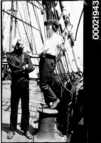 Unidentified mariner and young woman on the deck of a vessel, 1890-1939