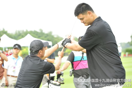 October 18th, 2012 - Yao Ming gets golf tips from Chinese golfer Zhang Lianwei at the Mission Hills World Celebrity Pro-Am Golf Tournament held October 19 to 21 in Haikou, Hainan Island