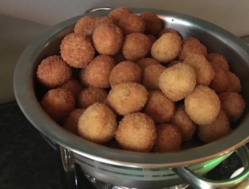 Bolitas de Yuca: mashed and fried yuca w/ huancaina sauce