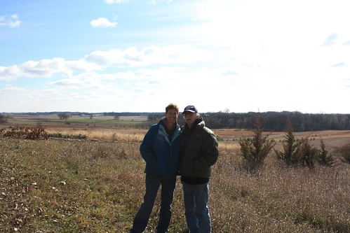 Mom and dad posing in front of the Minnesota prairie