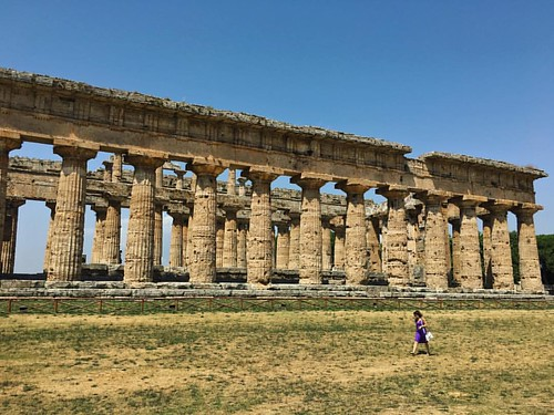 Partial View of the Tempio di Nettuno @ Poseidonia;  Temple of Neptune - The largest, most majestic of all the extremely large Greek Doric temples at Paestum. The lady in the picture included to show the sheer scale of this mammoth structure!  Looking acr