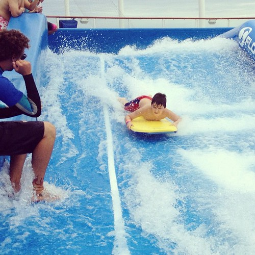 Surfin' Simon on the Flow Rider on the Allure of the Seas #fisherpricemoms #fisherpriceonroyal