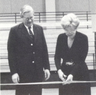 Martha (Mab) Voelkel and President David Alexander presided over the ribbon-cutting ceremony during the dedication November 11, 1990, of the Robert T. Voelkel Gymnasium in the Rains Center
