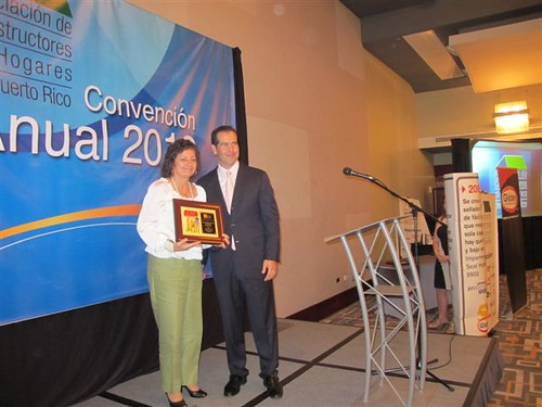 From left to right: Award Recipient: Arlene Zambrana receives her award from Alejandro Brito, President of Puerto Rico's Housing Builders Association.