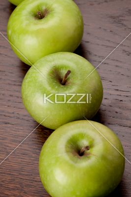row of green apples