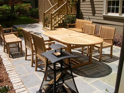 A Collection Of Teak Patio Furniture
