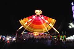 festival(0.0), performance(0.0), park(0.0), event(1.0), outdoor recreation(1.0), fair(1.0), night(1.0), amusement ride(1.0), amusement park(1.0),