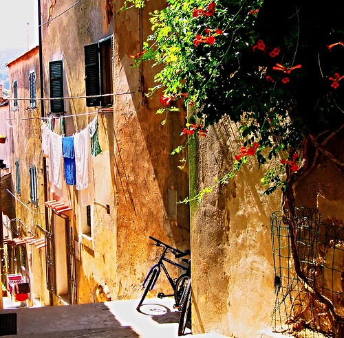 Elba Island. Alley with bicycle and clothes