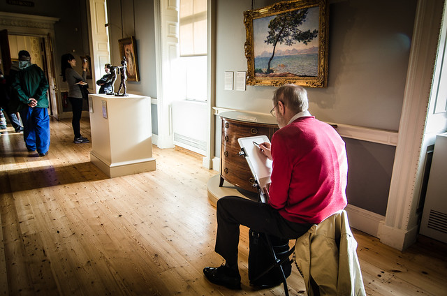 An artist sketches a pair of Degas statues at London's Courtauld Gallery.
