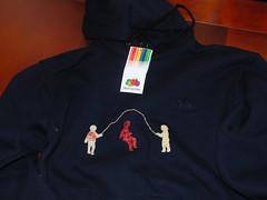 polo shirt(0.0), jacket(0.0), pocket(0.0), t-shirt(0.0), clothing(1.0), sleeve(1.0), hoodie(1.0), maroon(1.0), outerwear(1.0), hood(1.0),