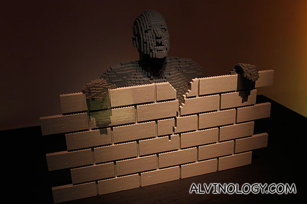Brick man behind a brick wall