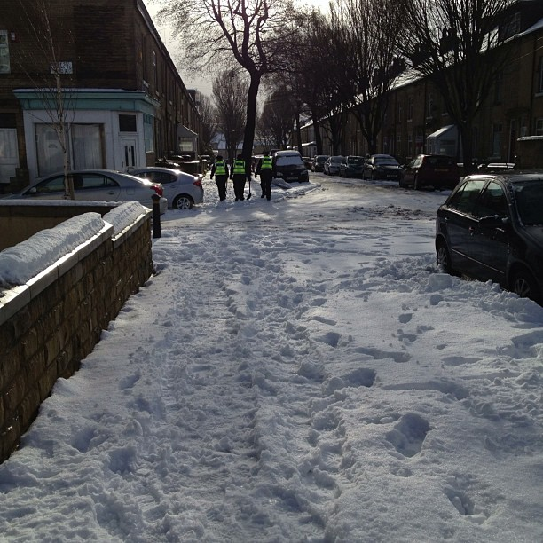 Three police ladies walked by with a shovel, one complaining about needing some wellingtons #snow #police