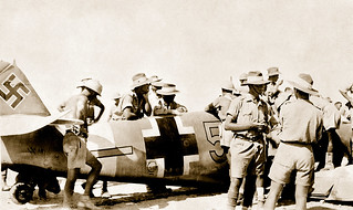 14 August 1942 - Australian Army, 9 Division Cavalry & British troops inspect a Messerschmitt Bf.109F-4/trop from it's crash landing site next to the coast road, behind Australian Army lines near the station at El Alamein, Egypt