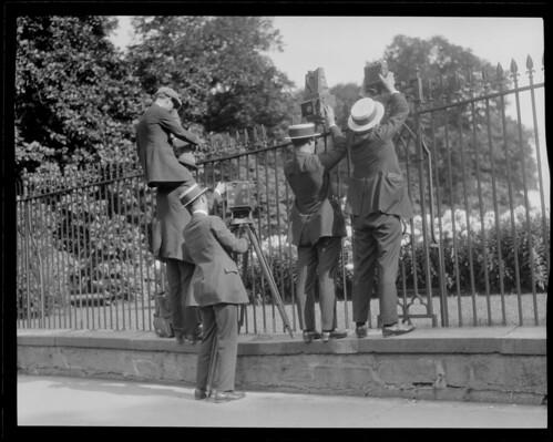 Photographers take pictures over fence when young Coolidge died of blood poisoning